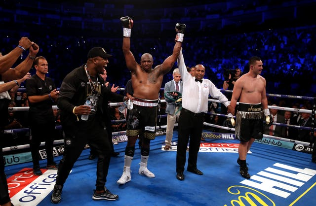 Dillian Whyte celebrates beating Joseph Parker