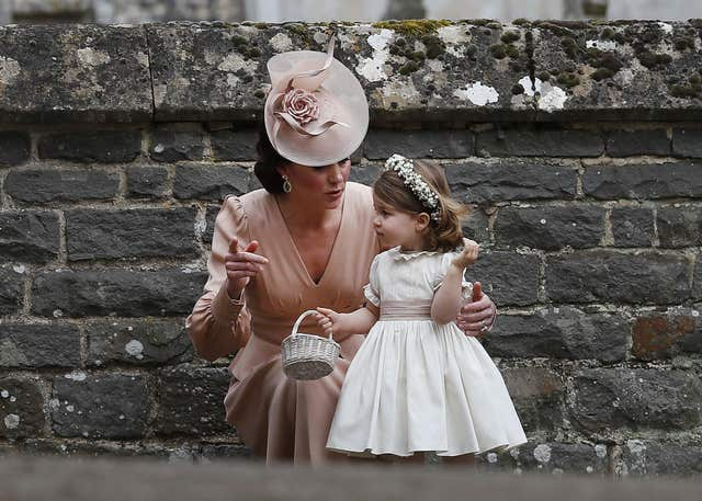 The Duchess of Cambridge with her daughter Princess Charlotte at Pippa Middleton's wedding (Kirsty Wigglesworth/PA)