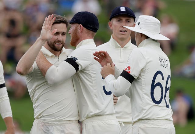 Chris Woakes, left, is congratulated after taking the wicket of New Zealand's Ross Taylor