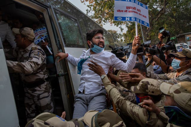 Police detain a member of the National Students' Union of India during the protest