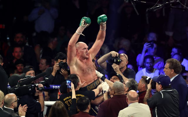 Tyson Fury, centre, is the WBC heavyweight champion (Bradley Collyer/PA)