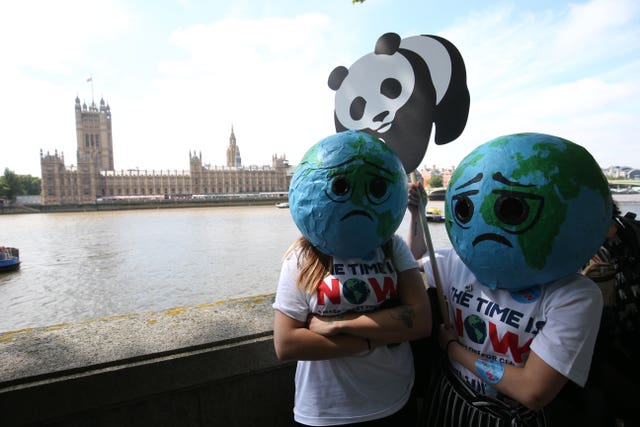 Campaigners were urging MPs to take action on climate and the environment (Jonathan Brady/PA)