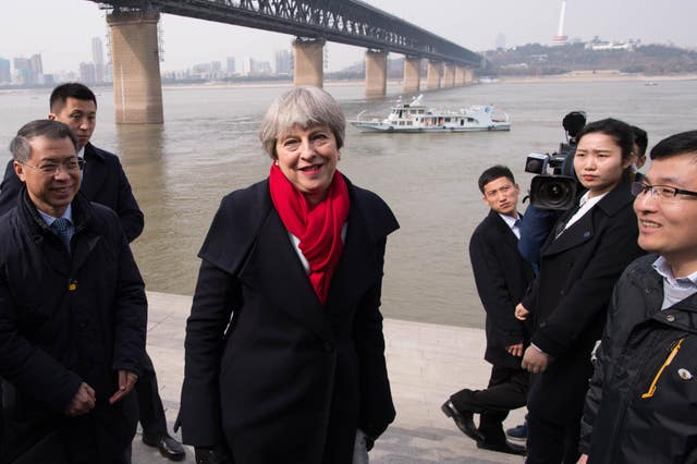 Theresa May looks out over the Yangtze River in Wuhan (Stefan Rousseau/PA)