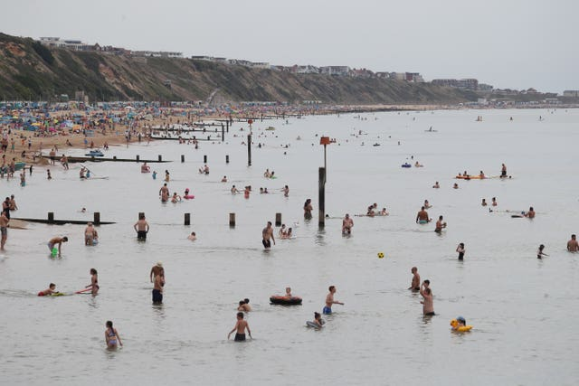 Swimming in the sea at Boscombe beach in Dorset