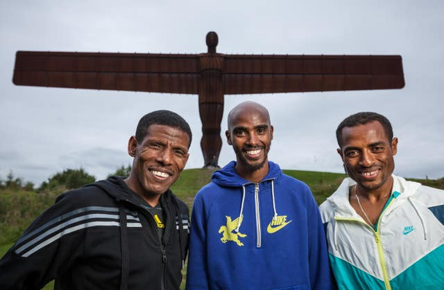 Gebrselassie, Farah and Ethiopia's Kenensia Bekele pose at the Angel of the North