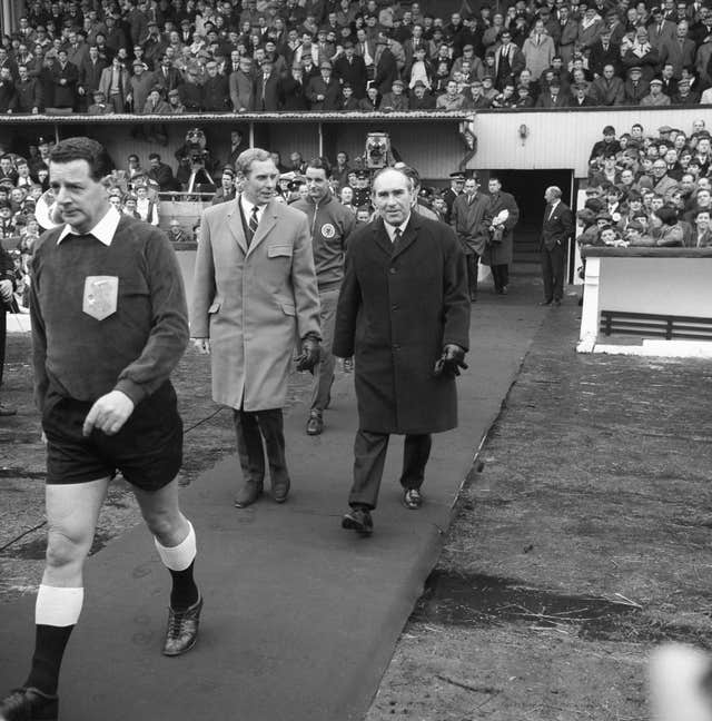 Bobby Brown, left, walks out with England manager Alf Ramsey