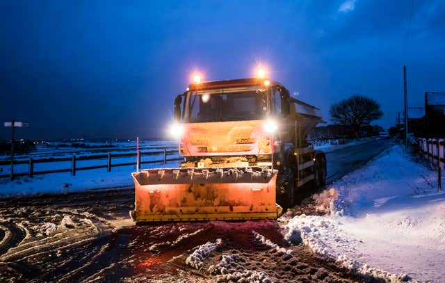 A gritter in snowy conditions near Snowden Hill in Sheffield, South Yorkshire (Danny Lawson/PA)