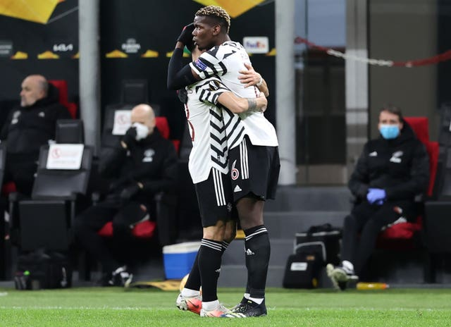 Paul Pogba celebrates his matchwinner in Milan