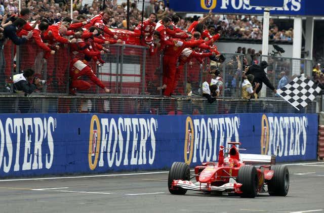 Michael Schumacher celebrating another win for Ferrari