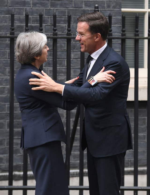 Prime Minister Theresa May greets the Dutch Prime Minister Mark Rutte outside 10 Downing Street in London