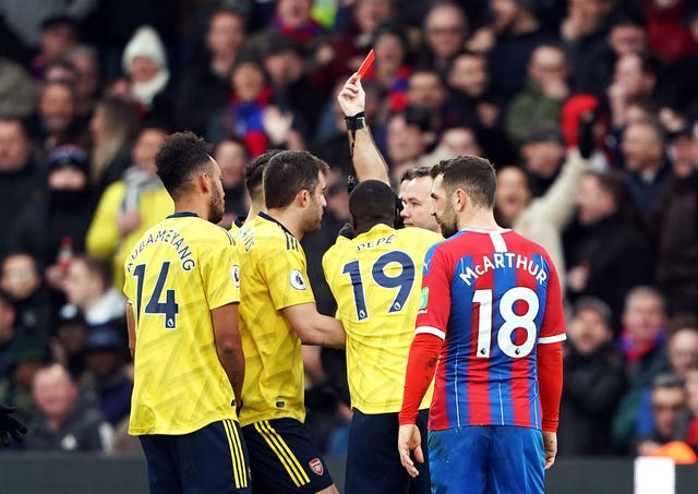 Referee Paul Tierney shows Pierre-Emerick Aubameyang (left) a red card following a VAR review