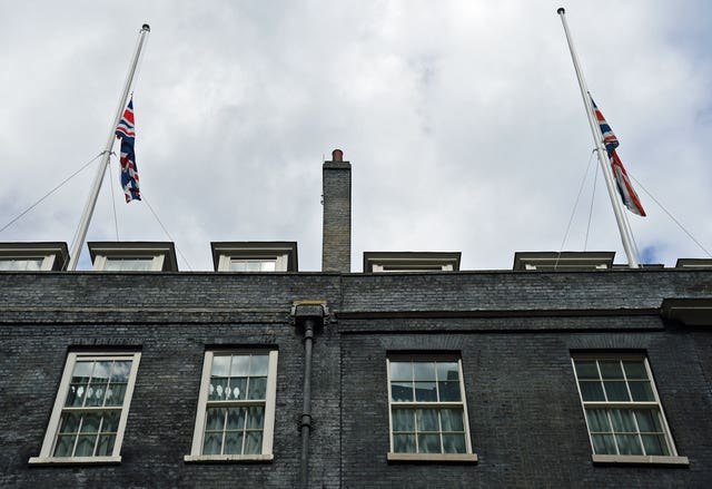 Union Flags are at half mast at Government buildings like Downing Street (Kirsty O'Connor/PA)