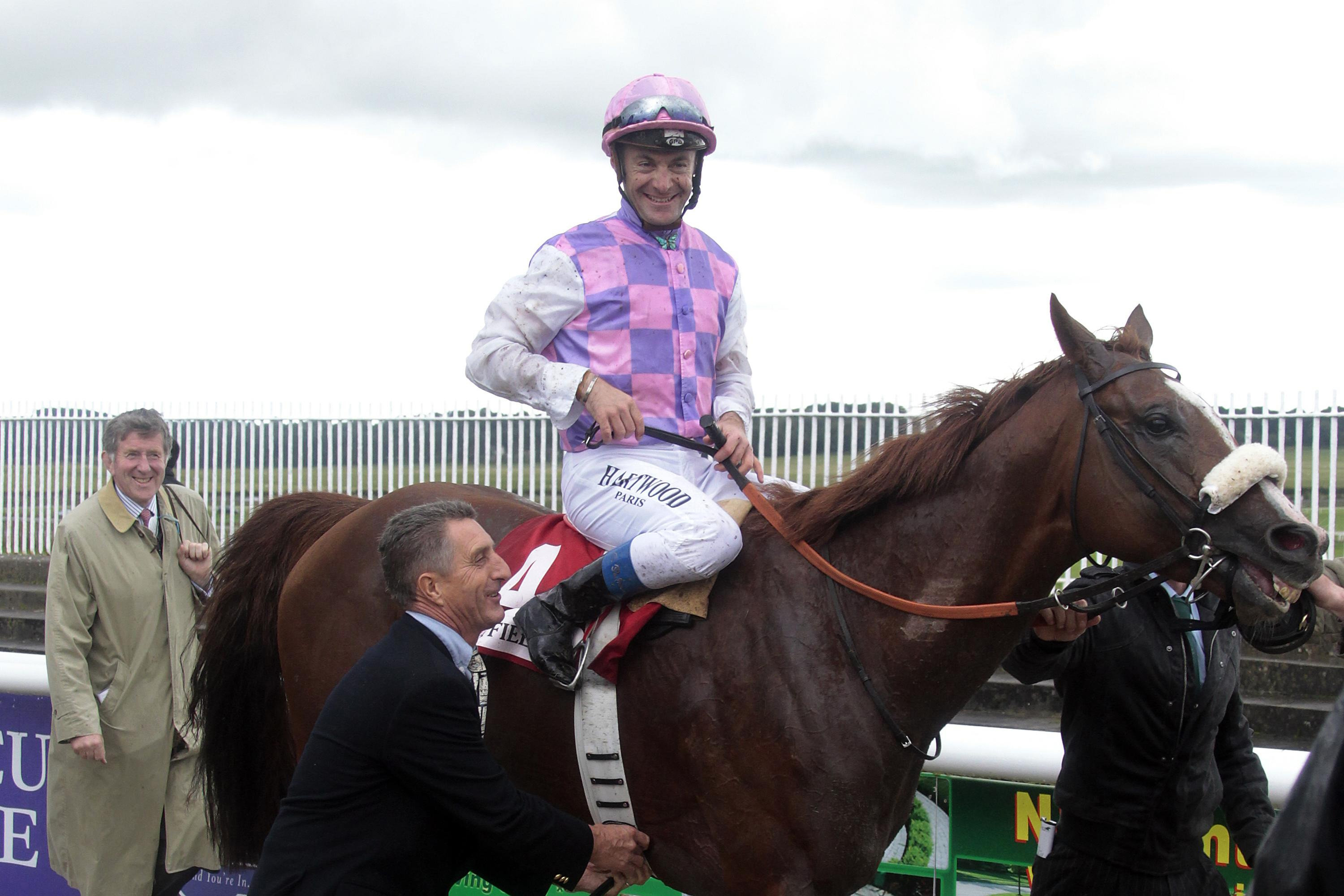 Sans Frontieres and Olivier Peslier after winning the Irish St Leger