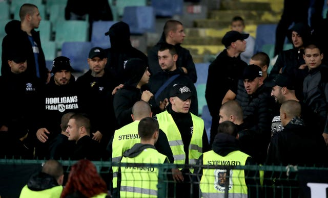 Stewards speak to Bulgaria fans during the Euro 2020 qualifier against England