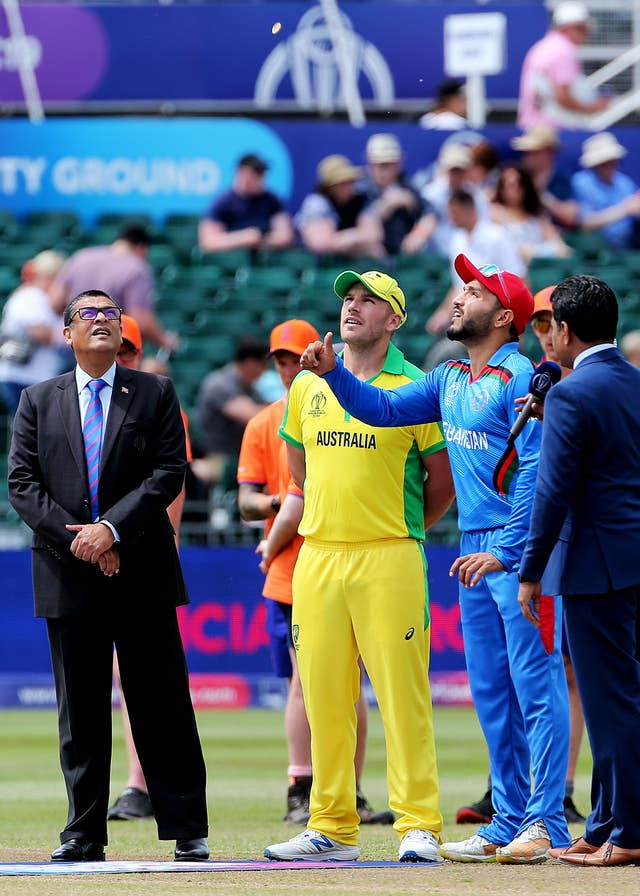 Australia captain Aaron Finch, centre, at the coin toss against Afghanistan