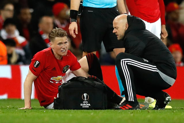 Manchester United midfielder Scott McTominay, pictured receiving treatment for an injury during a Europa League clash with Partizan Belgrade, will miss the trip to Sheffield United.