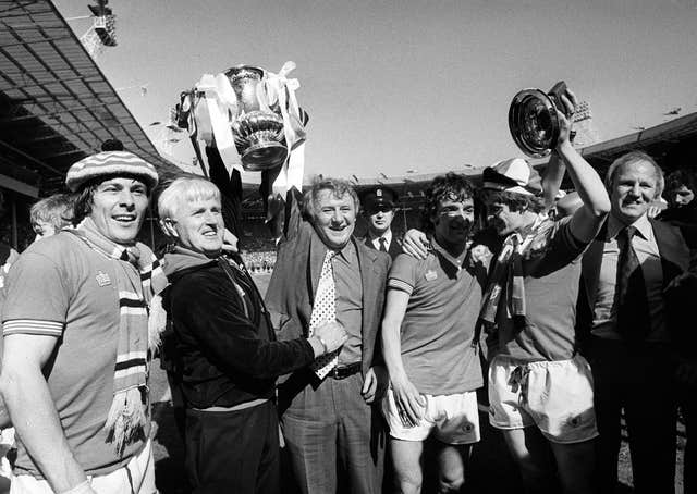 Tommy Docherty celebrates winning the 1977 FA Cup with Manchester United