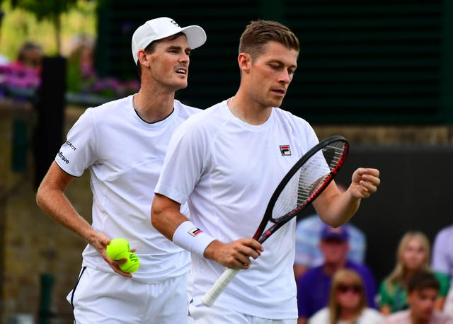 Jamie Murray (left) and Neal Skupski lost their first-round men's doubles match