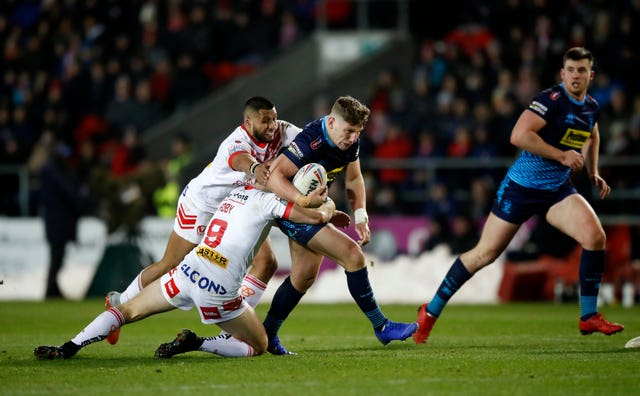 St Helens' Dominique Peyroux and James Roby hold up Wigan