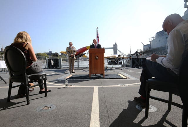 Defence Secretary Ben Wallace with Chief of Defence Staff General Sir Nick Carter speaking to assembled press during his visit to HMS Tamar in London