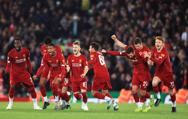Liverpool players celebrate winning the penalty shootout against Arsenal