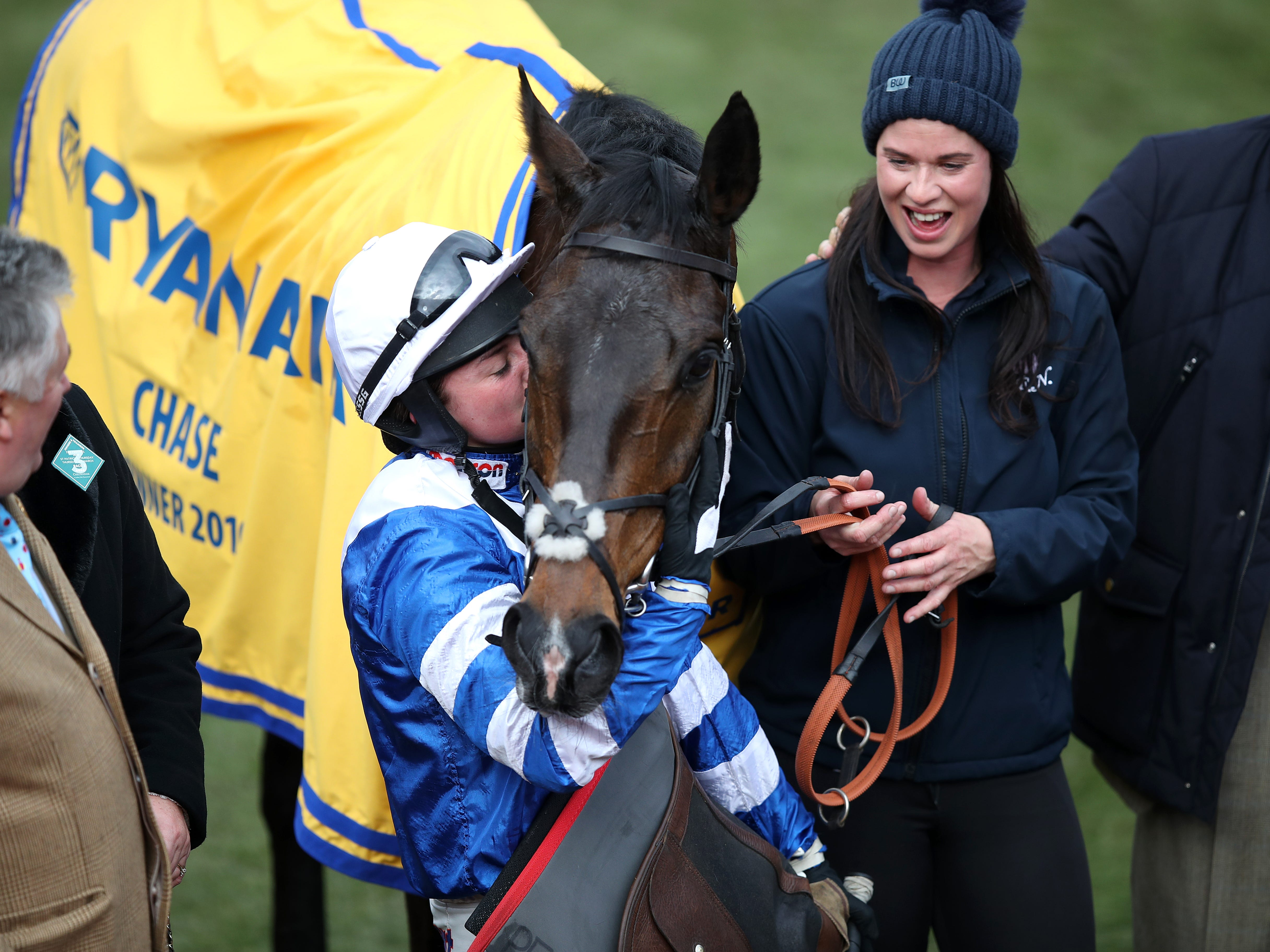 Bryony Frost gives Ryanair Chase hero Frodon a well-deserved kiss (Andrew Matthews/PA)