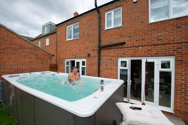 Adam Peaty trains at his house in Loughborough