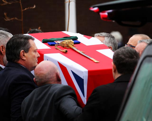 Surgeon Captain Rick Jolly's coffin dressed with the Union flag, his medals, sword and green beret (LPhot Ken Gaunt/Royal Navy/MoD/Crown copyright/PA)
