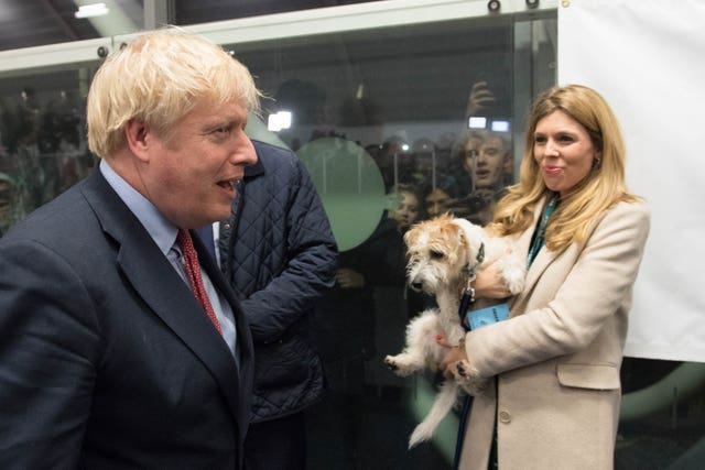 Boris Johnson and Carrie Symonds with their dog,  Dilyn