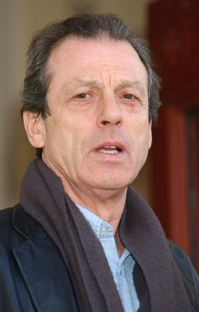 According to reports, former EastEnders star Leslie Grantham is fighting for his life in hospital (Yui Mok/PA)