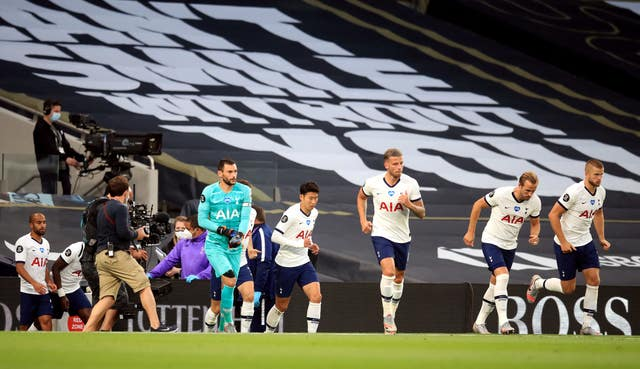 Hugo Lloris, centre left, and Son Heung-min, centre right, come out at the start of the second half
