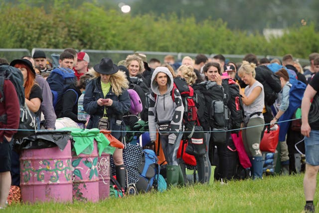 People arrive on the first day of the Glastonbury Festival