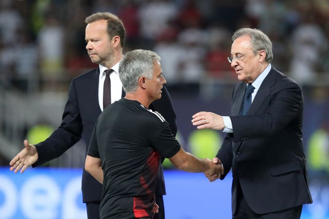 Former Manchester United manager Jose Mourinho (centre) and vice-chairman Ed Woodward (left). (Nick Potts/PA Images)