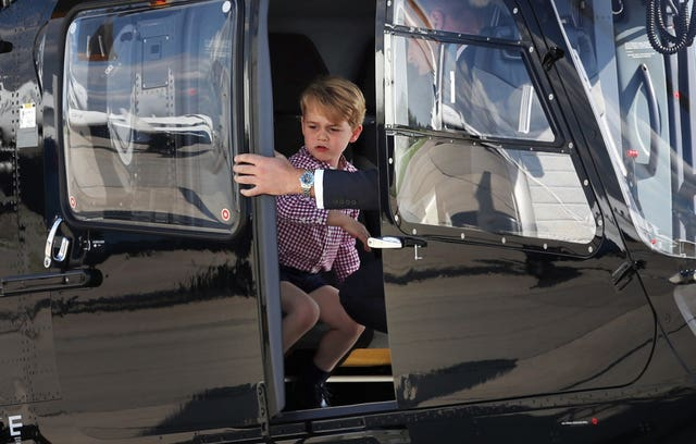 Prince George stands in a rescue helicopter during a visit to Airbus in Hamburg, Germany (Jane Barlow/PA)