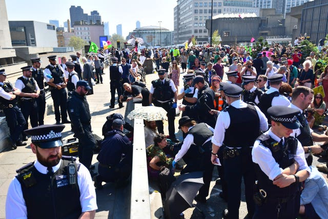 Police remove Extinction Rebellion demonstrators on Waterloo Bridge