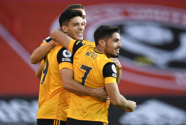 Raul Jimenez (left) celebrates scoring in Wolves' win at Bramall Lane on the opening weekend of the season.