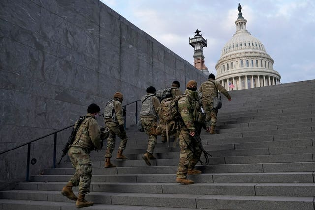 National Guard members take a staircase toward the US Capitol building (Patrick Semansky/AP)