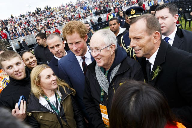 Prince Harry and Australian Prime Minister Tony Abbott attend a memorial service at Lone Pine, Eceabat, Turkey