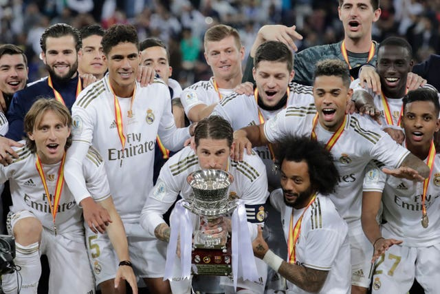 Ramos kisses the trophy as Real prepare to celebrate
