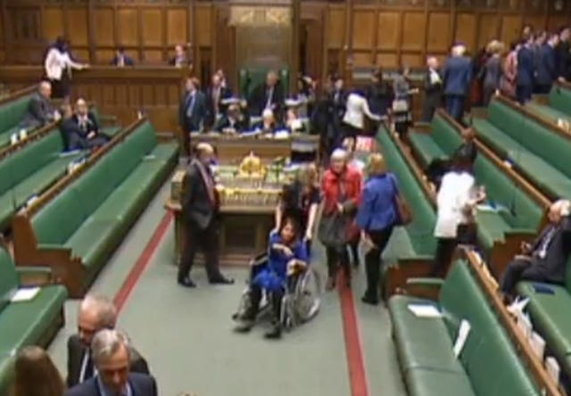 Labour MP Tulip Siddiq is wheeled through the chamber