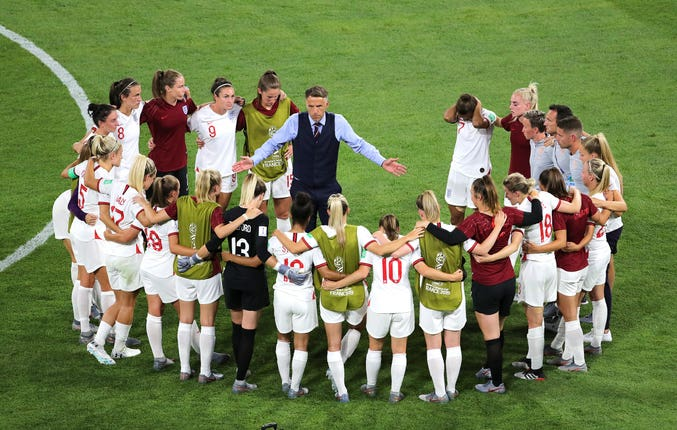 England head coach Phil Neville talks to his players during the World Cup semi-final