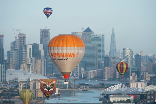 Hot air balloons fly over London