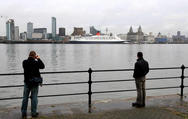 The QE2 sits docked on the River Mersey in Liverpool in 2007 (Martin Rickett/PA)