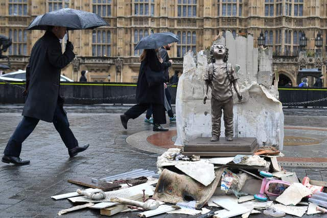A life-size statue of a child placed by Save the Children next to the Houses of Parliament to draw attention to the war in Yemen ahead of the visit of the Crown Prince (Dominic Lipinski/PA)