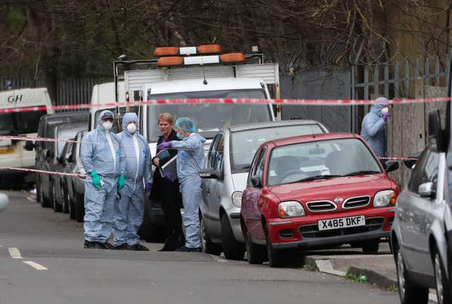 Forensic officers on Further Green Road (Gareth Fuller/PA)