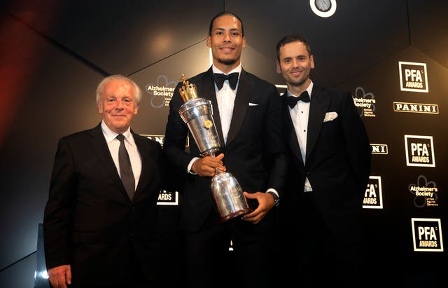 Gordon Taylor, left, with PFA Player of the Year for 2019 Virgil Van Dijk, centre, and PFA chairman Ben Purkiss, right