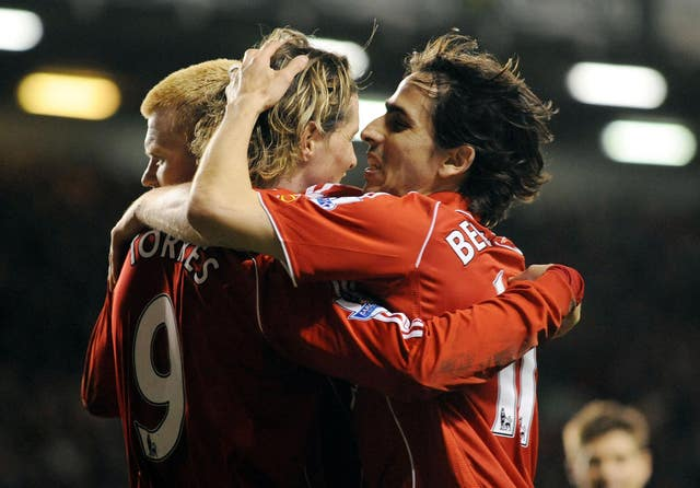 Fernando Torres celebrates his hat-trick with John Arne Riise and Yossi Benayoun