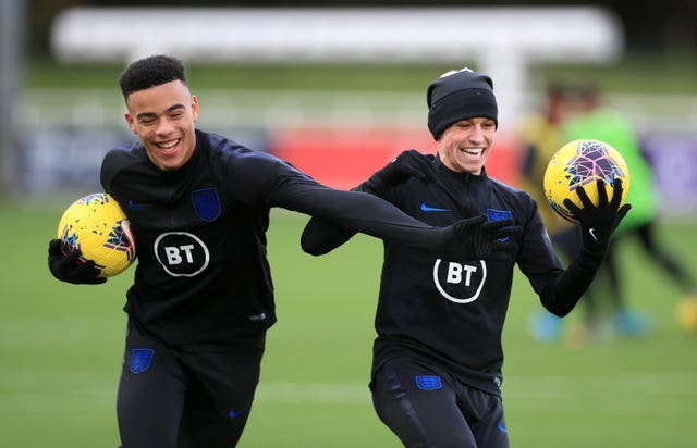 Mason Greenwood (left) and Phil Foden ha made their England debuts on Saturday