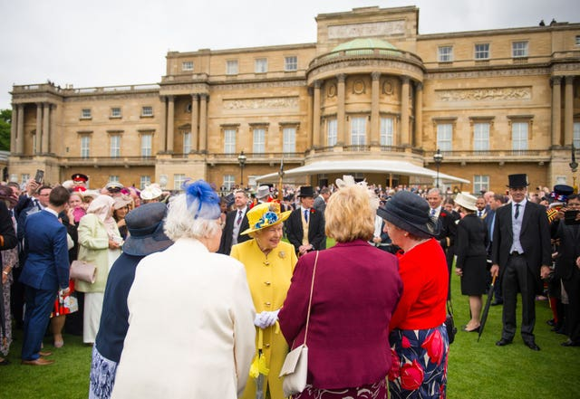 The Queen greeting guests during a garden party at Buckingham Palace