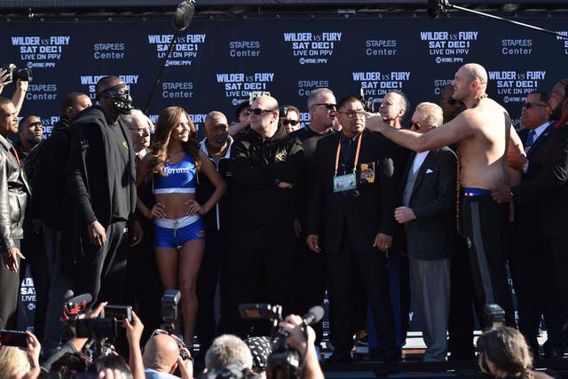 Deontay Wilder and Tyson Fury attend the weigh-in